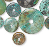Focal mix, turquoise (dyed / stabilized), 10-54mm donut, D grade, Mohs hardness 5 to 6. Sold per 1/4 pound pkg.