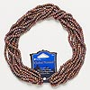 Seed bead, Blue Moon Beads®, glass, brown rainbow, #6. Sold per pkg of (8) 14-inch strands.