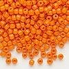 Seed bead, Dyna-Mites™, glass, opaque orange, #6 round. Sold per 40-gram pkg.